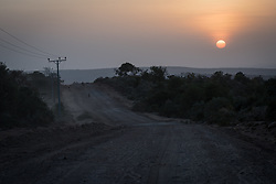 27 January 2019, Bale Zone, Oromia, Ethiopia: As the sun rises, people walk in search of water along the road from Ginnir to Micha in the Bale Zone of Ethiopia.