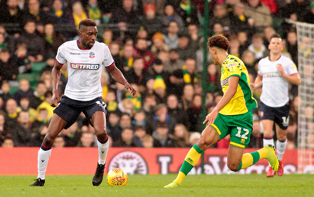 Bolton Wanderers' Sammy Ameobi tries to find a way past Norwich City's Jamal Lewis<br /> <br /> Photographer David Shipman/CameraSport<br /> <br /> The EFL Sky Bet Championship - Norwich City v Bolton Wanderers - Saturday 8th December 2018 - Carrow Road - Norwich<br /> <br /> World Copyright © 2018 CameraSport. All rights reserved. 43 Linden Ave. Countesthorpe. Leicester. England. LE8 5PG - Tel: +44 (0) 116 277 4147 - admin@camerasport.com - www.camerasport.com