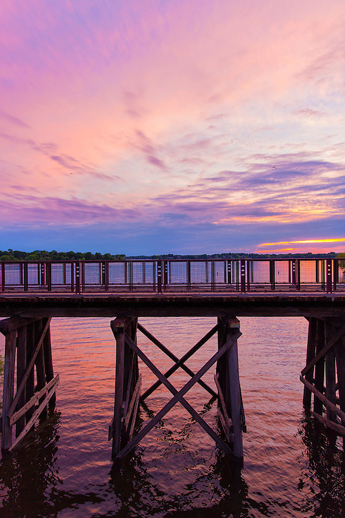 Portrait View Of The Arcola Bridge Over Lake Minnetonka, Minnesota at Sunset Withe pink and purple skies