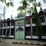 May 15, 2013 - Meiktila, Myanmar: People pass by a damaged mosque in a Muslim quarter, which was razed by Buddhists in ethnic violence against muslim early in the year, in Meikhtila, central Myanmar. (Paulo Nunes dos Santos/Polaris)