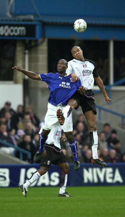 10/01/2004 - Photo  Peter Spurrier<br /> 2003/04 Barclaycard Premiership Fulham v Everton <br /> Fulham'sZat Knight [right] and Kevin Campbell contest the high ball.