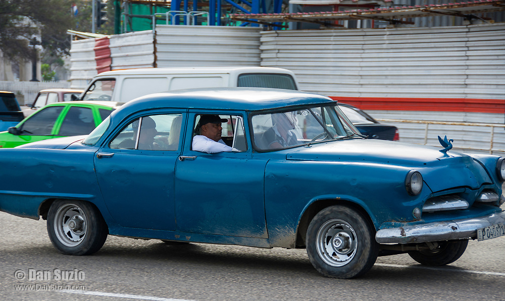 Havana, Cuba - A taxi on the Malecón road facing Havana Bay. Classic American cars from the 1950s, imported before the U.S. embargo, are commonly used as taxis in Havana.