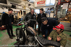 Go Takamine (red hat) with Harley-Davidson's design team including (L>R) Ben McGinley, team leader Ray Drea, Charlie Wartgow, and Dais Nagao, during their visit to Go's Brat Style shop. Tokyo, Japan. Monday, December 8, 2014. Photograph ©2014 Michael Lichter.