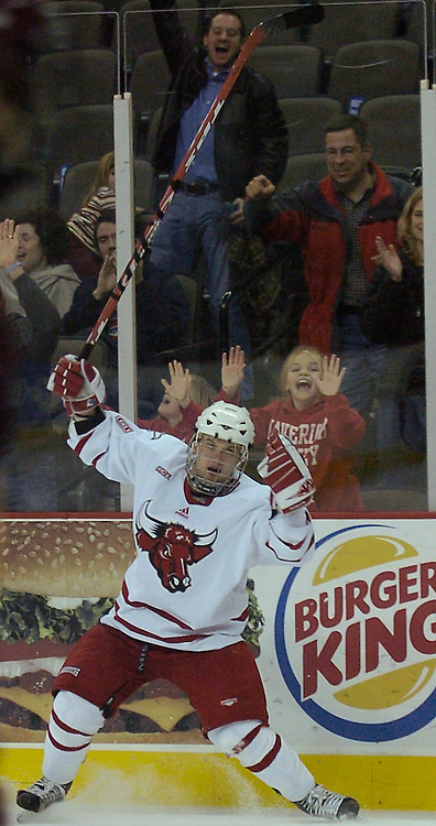 12/4/05  Omaha, NE University of Nebraska at Omaha's Tomas Klempa celebrates with the fans at Qwest Center Omaha Sunday afternoon against Ferris State(photo by Chris Machian/Prarie Pixel Group)