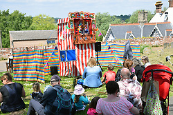 Beccles Food & Drink Festival, May 2019, Suffolk UK. Stokes stall. Punch & Judy stall