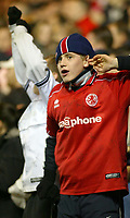 """Photo. Andrew Unwin.<br /> Middlesbrough v Everton, Carling Cup Fourth Round, Riverside Stadium, Middlesbrough 03/12/2003.<br /> """"I can't hear you"""" says a Middlesbrough supporter as his team take the lead in the penalty shoot-out."""