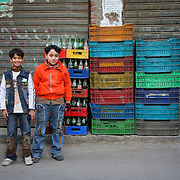 Two local boys pose near colourful crates, Cairo, Egypt (January 2008)