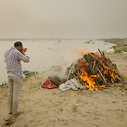 A cremation on the Yamuna river, a holy river to Hinduism. Ashes are thrown in the river.