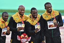 30-08-2015 CHN: IAAF World Championships Athletics day 9, Beijing<br /> 400 m relay  Nesta CARTER, Asafa POWELL, Nickel ASHMEADE en Usain BOLT JAM<br /> Photo by Ronald Hoogendoorn / Sportida