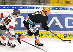 03.01.2021, Keine Sorgen Eisarena, Linz, AUT, ICE, Black Wings 1992 vs iClinic Bratislava Capitals, im Bild v.l. Lukas Bohunicky (iClinic Bratislava Capitals) Brian Lebler (Steinbach Black Wings 1992) // during the bet-at-home ICE Hockey League match between Black Wings 1992 and iClinic Bratislava Capitals at the Keine Sorgen Eisarena in Linz, Austria on 2021/01/03. EXPA Pictures © 2020, PhotoCredit: EXPA/ Reinhard Eisenbauer