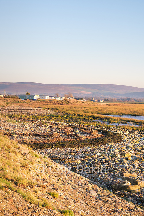 Stony and marshy foreshore in front of Caravan Park at Cockerham Sands