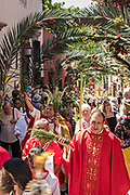 A Roman Catholic priest leads christian believers in a procession through the city center during Palm Sunday marking the start of Holy Week March 25, 2018 in San Miguel de Allende, Mexico. Christians commemorate the entry of Jesus into Jerusalem when it was believed that the citizens laid down palm branches in his path.