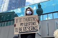 """06 JUN 2020, BERLIN/GERMANY:<br /> Frau mit Schild """"If it Theatens my Existence I´ll be Resistance"""", im Hintergrund eine Spiegelung des Fernsehturms, """"Silent Demo"""" anl. des gewaltsamen Todes des US-Afroamerikaners George Floyd durch Polizeigewalt in Minneapolis, Alexanderplatz<br /> IMAGE: 20200606-01-005<br /> KEYWORDS: Demonstration, demonstrator, Protest, Black Lives Matter, #blacklivesmatter"""