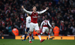 Arsenal's Laurent Koscielny celebrates after teammates Arsenal's Alexis Sanchez (out of picture) celebrates scoring their second goal of the game