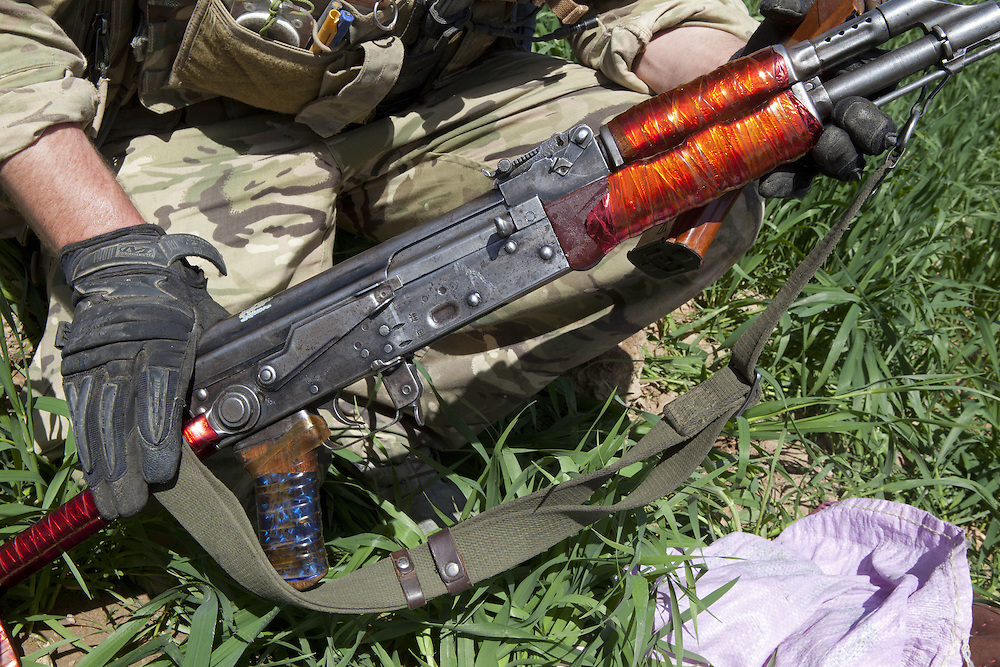British soldiers of 16 Air Assault Bde's elite BRF (Brigade Reconnaissance Force) examine an Kalashnikov assault weapon found whilst searching fields and compounds as part of an operation in the village of Kakaran in Helmand Province, Southern Afghanistan on the 14th of March 2011.