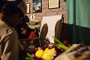 TEGUCIGALPA, HONDURAS - NOVEMBER 13, 2013: A boy and man observe the casket of Felipe Nery Aguilar Rodríguez (71) who was murdered with Gladys Ondina Aguilar Rodríguez (40), inside of their house in Comayagüela on the outskirts of Tegucigalpa. CREDIT: Rodrigo Cruz for The New York Times