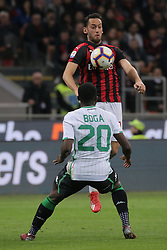March 2, 2019 - Milan, Milan, Italy - Hakan Calhanoglu #10 of AC Milan competes for the ball with Jeremie Boga #20 of US Sassuolo during the serie A match between AC Milan and US Sassuolo at Stadio Giuseppe Meazza on March 02, 2019 in Milan, Italy. (Credit Image: © Giuseppe Cottini/NurPhoto via ZUMA Press)