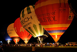 © Licensed to London News Pictures. 08/08/2013. Bristol, UK. The Nightglow where balloons use their gas burners to light up in time to music, at the Bristol International Balloon Fiesta 2013. The event is Europe's biggest annual ballooning event.  08 August 2013.<br /> Photo credit : Simon Chapman/LNP