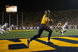 Cailfornia quarterback Chase Garbers (7) rolls out to pass during the fourth quarter of an NCAA college football game against Nevada, Saturday, Sept. 4, 2021, in Berkeley, Calif. (AP Photo/D. Ross Cameron)