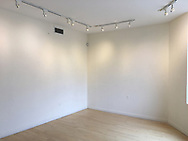 """Huntington, New York USA. March 27, 2017. After end of """"Her Story Through Art"""" Invitational Exhibition celebrating Women's History Month, artwork is taken down at Main Street Gallery at Huntington Arts Council."""