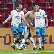 Trabzonspor's Burak YILMAZ (C) celebrate his goal during their Turkish superleague soccer derby match Galatasaray between Trabzonspor at the TT Arena in Istanbul Turkey on Sunday, 10 April 2011. Photo by TURKPIX