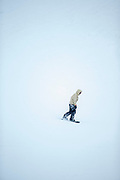Man snowboarding at ski resort, Nagano, Japan