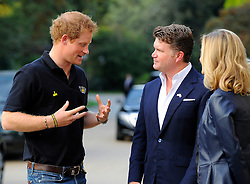 His Royal Highness, Prince Harry speaks with the Ambassador of the United States of America <br /> to the United Kingdom of Great Britain and Northern Ireland, Matthew W. Barzun - Photo mandatory by-line: Joe Meredith/JMP - Mobile: 07966 386802 - 9/09/14 - Winfield reception for the Invictus Games - London - Winfield House