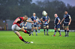 Gordon Ross (London Welsh) kicks for the posts as Bristol Rugby players look on - Photo mandatory by-line: Patrick Khachfe/JMP - Tel: Mobile: 07966 386802 28/05/2014 - SPORT - RUGBY UNION - Kassam Stadium, Oxford - London Welsh v Bristol Rugby - Greene King IPA Championship.