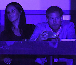 Prince Harry, Meghan Markle and Meghan's Mother Doria Radlan attend The Invictus Games 2017 Closing Ceremony at the Air Canada Centre, Toronto, Ontario, Canada, on the 30th September 2017. 30 Sep 2017 Pictured: Meghan Markle, Prince Harry. Photo credit: James Whatling / MEGA TheMegaAgency.com +1 888 505 6342