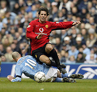 Photo. Aidan Ellis.<br /> Manchester City v Manchester United.<br /> FA Barclaycard Premiership.<br /> 14/03/2004.<br /> United's Ruud Van Nistelrooy and City's Antoine Sibierski