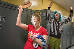 """Ringling Brothers in Fairfax, Va.Clown DJ Weiss cheers after successfully """"pie""""ing a fellow performer, aerialist Samantha Pitard, after one of the shows in Fairfax, Va. It is customary for the clowns to pie colleagues on their birthdays. <br /> <br /> Ringling Bros. and Barnum & Bailey Circus started in 1919 when the circus created by James Anthony Bailey and P. T. Barnum merged with the Ringling Brothers Circus. Currently, the circus maintains two circus train-based shows, the Blue Tour and the Red Tour, as well as the truck-based Gold Tour. Each train is a mile long with roughly 60 cars: 40 passenger cars and 20 freight. Each train presents a different """"edition"""" of the show, using a numbering scheme that dates back to circus origins in 1871 — the first year of P.T. Barnum's show."""