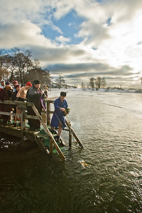 Father Mitro blesses the ice swimming place in Helsinki, Finland. There are strong traditions for ice swimming and dousing with cold water for health benefits, as a ritual of the Orthodox Church for the feast of the Baptism of Our Lord, and for sports.