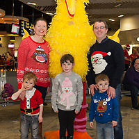 Mum Olive and Dad Paul O'Sullivan from Lissycasey, with their kids Shane, Niamh and Liam pictured with Big Bird waitng for their flight with Santa from Shannon Airport