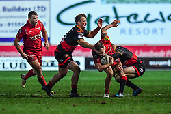 Scarlets' Ioan Nicholas is tackled by Dragons' Sarel Pretorius<br /> <br /> Photographer Craig Thomas/Replay Images<br /> <br /> Guinness PRO14 Round 13 - Scarlets v Dragons - Friday 5th January 2018 - Parc Y Scarlets - Llanelli<br /> <br /> World Copyright © Replay Images . All rights reserved. info@replayimages.co.uk - http://replayimages.co.uk