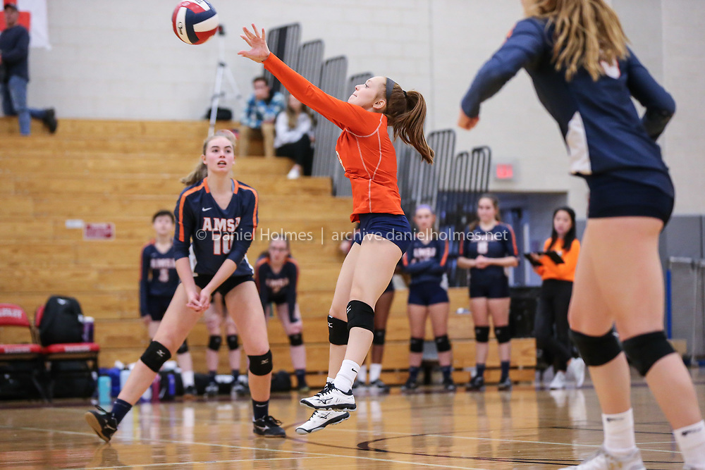 (11/9/19, WELLESLEY, MA) AMSA's Isabella Rand  sets the ball during the Div.3 Central final against Whitinsville Christian at Wellesley High School on Saturday. [Daily News and Wicked Local Photo/Dan Holmes]