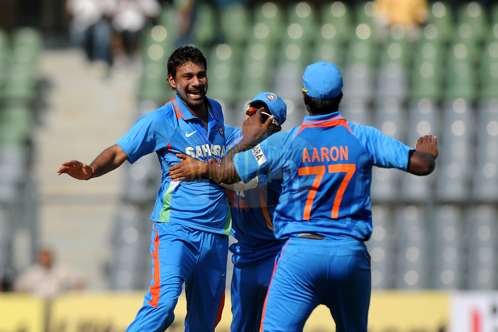 Praveen Kumar of India celebrate the wicket of Craig Kieswetter of England during the 4th One Day International ( ODI ) match between India and England held at the Wankhede Stadium, Mumbai on the 23rd October 2011..Photo by Pal Pillai/BCCI/SPORTZPICS