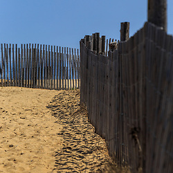 Bethany Beach, DE / USA - April 18, 2015: The dune fence along the walkway to the beach in Bethany, Delaware.