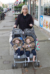 Childminder with twins in buggy, (This photo has extra clearance covering Homelessness, Mental Health Issues, Bullying, Education and Exclusion, as well as the usual clearance for Fostering & Adoption and general Social Services contexts,)