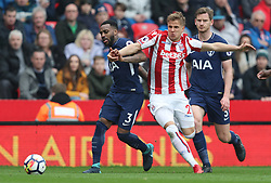 Stoke City's Moritz Bauer and Tottenham Hotspur's Danny Rose battle for the ball