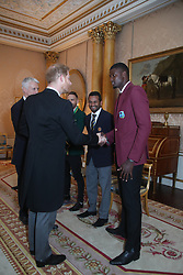 The Duke of Sussex meets West Indies cricket captain Jason Holder (right), South Africa cricket captain Francois du Plessis (left) and Sri Lanka captain Dimuth Karunaratne (centre). The captains of the teams taking part in the ICC Cricket World Cup meet for a photograph in the 1844 Room at Buckingham Palace in London, ahead of the competition's Opening Party on the Mall.