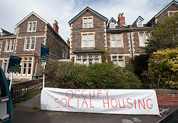 © Licensed to London News Pictures.21/04/2016. Bristol, UK.  Members of Bristol Housing Action Movement (BHAM) occupy a council house on Cotham Lawn Road in protest at its being sold in an auction of council houses held the previous evening. The property reportedly sold for £462,000, much higher than the guide price of £280,000. Campaigners want the council to stop selling off 14 council homes to the private sector. Bristol City Council says the homes are expensive to repair, but some campaigners question whether the costs of repairs are inflated, and also whether the homes will be bought and then relet to the Council for temporary accommodation at higher than normal rents. Photo credit : Simon Chapman/LNP