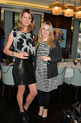 Left to right, GABRIELA PEACOCK and AMANDA HARRINGTON at the 'Ladies of Influence Lunch' held at Marcus, The Berkeley Hotel, London on 12th May 2014.