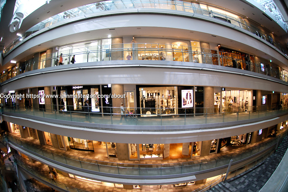 Interior of atrium of upmarket Omotesando Hills shopping mall in Tokyo Japan architect Tadao Ando