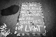 Calais, France, 5 Februari 2015, At squat Gallo people wrote this slogan on the ground.