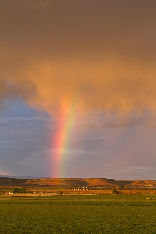 Spring Rainbow along the Snake River Plain near Hammett, Idaho. Licensing and Open Edition Prints.
