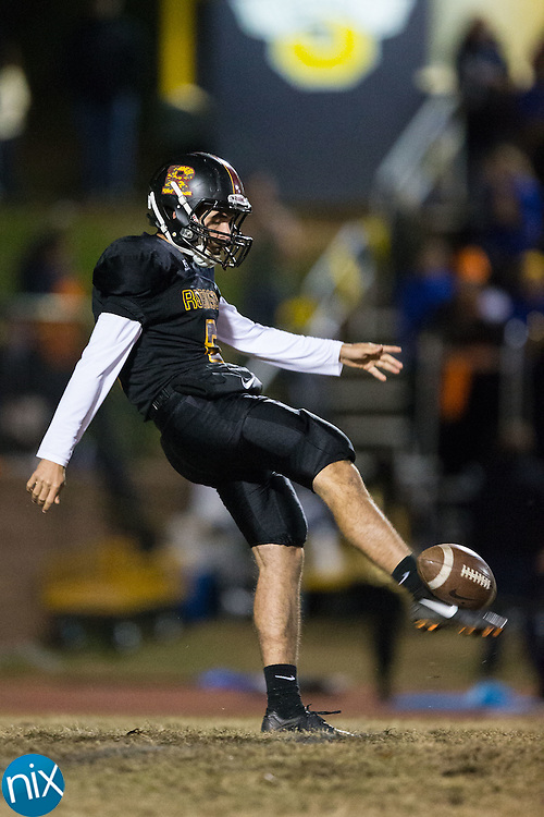 Joseph Bruner (3) of the JM Robinson Bulldogs punts the football during first half action against the South Iredell Vikings at South Iredell High School November 20, 2015, in Statesville, North Carolina.  The Vikings defeated the Bulldogs 14-13.  (Brian Westerholt/Special to the Tribune)
