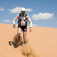 26 March 2007:  #204 Sebastien Confiant of France runs across dunes during the second stage (21.7 miles) of the 22nd Marathon des Sables between Khermou and jebel El Otfal. The Marathon des Sables is a 6 days and 151 miles endurance race with food self sufficiency across the Sahara Desert in Morocco. Each participant must carry his, or her, own backpack containing food, sleeping gear and other material.