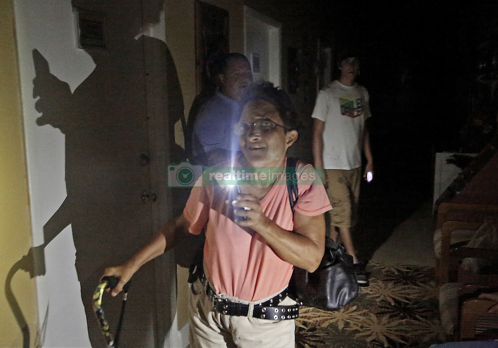 October 7, 2016 - Palm Bay, FL, USA - Residents and staffers navigate the Tropical Inn Resort as Hurrican Matthew barrels down the Treasure Coast on Oct. 7, 2016 in Palm Bay, Fla. (Credit Image: © Carl Juste/TNS via ZUMA Wire)