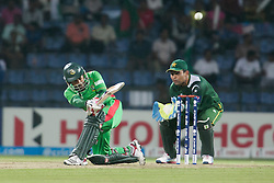 © Licensed to London News Pictures. 25/09/2012. Bangladesh batsmen Mushfiqur Rahim plays a sweep shot for 6 runs during the T20 Cricket World T20 match between Pakistan Vs Bangladesh at the Pallekele International Stadium Cricket Stadium, Pallekele. Photo credit : Asanka Brendon Ratnayake/LNP