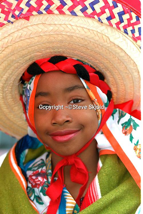 Cinco de Mayo parade participant in sombrero age 13.  St Paul Minnesota USA